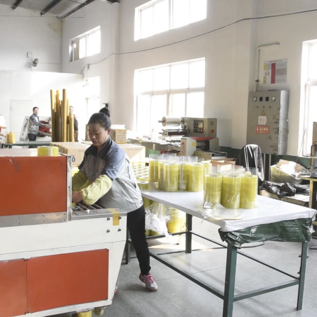 Small Manual Shrink Film Tape Packing Machine pictures & photos