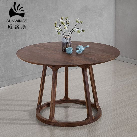Solid Wood Round Dining Table in Walnut Color pictures & photos