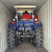 Tractor loading container
