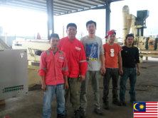 Engineer adjusting gravity separator in Malayisa