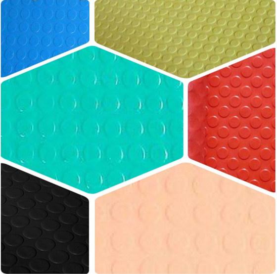 Studded rubber floor tiles