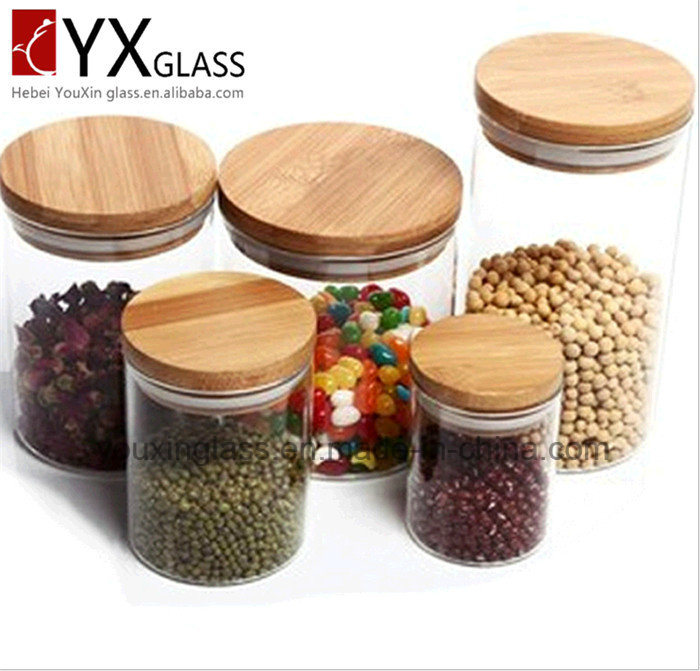 2016 Popular Cheap Borosilicate Storage Glass Jar with Wooden Lid Hermetic Pot Glass Sealed Cans Collection Glass Storage Tank Glassware