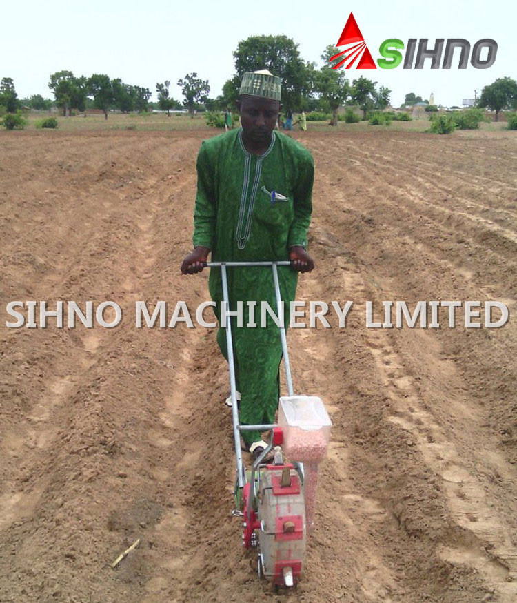 Walking Behind Hand Push Manual Seeder for Corn/Bean/Peanut/Vegetable