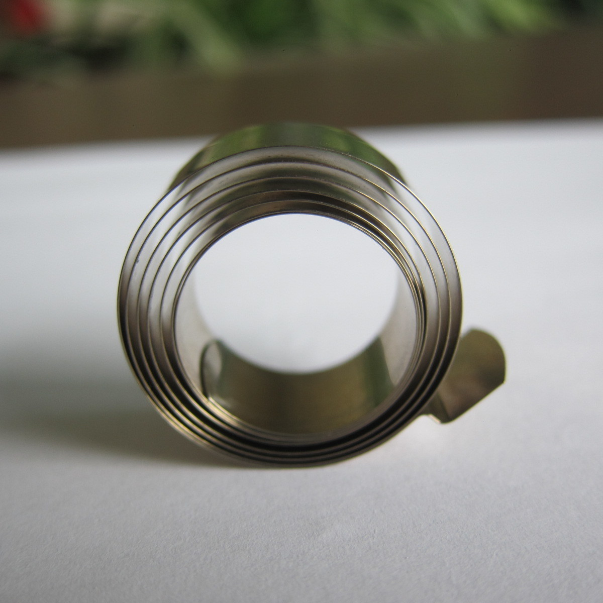 Spiral Power Spring Variable Force for Display Shelf Pusher