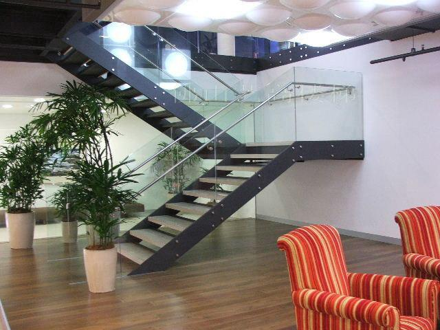 Modern Open Riser Stairs With Double Steel Stringer And Glass Railing
