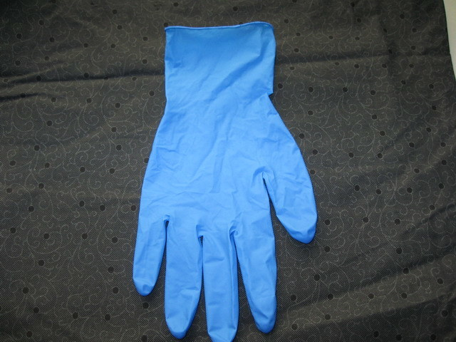 Hot Sale and Stock for Light Blue Color Finger-Tip Textured Disposable Nitrile Gloves