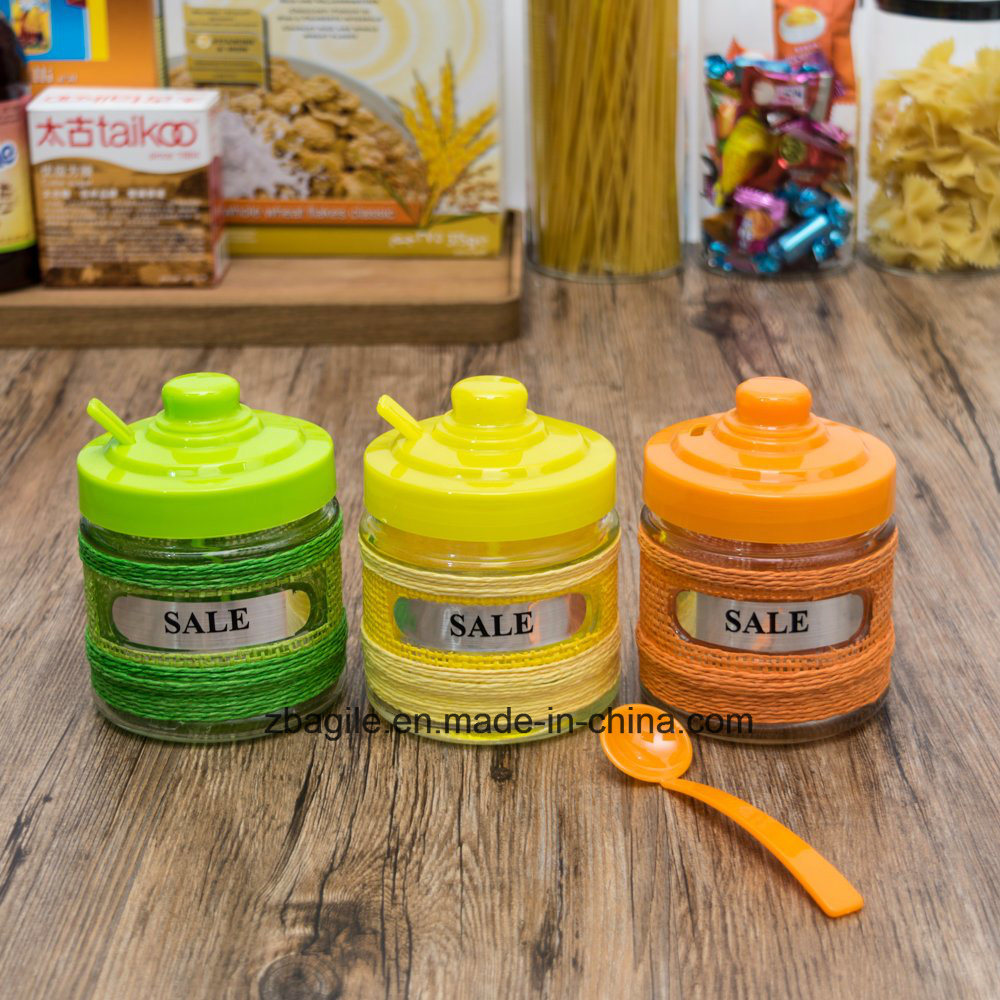 Factory Price Wholesale Colored Spice Storage Glass Jar with Plastic Lid and Spoon