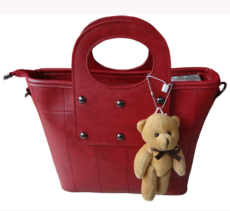 Hot Sale Fashion Women′s Hand Bag with Bear Accessories