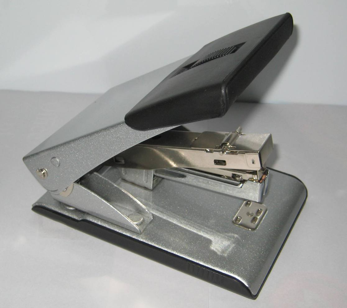 http://image.made-in-china.com/2f0j00NMVaEeTBblkC/Paper-Hole-Punch-With-Stapler-NO-2421-.jpg