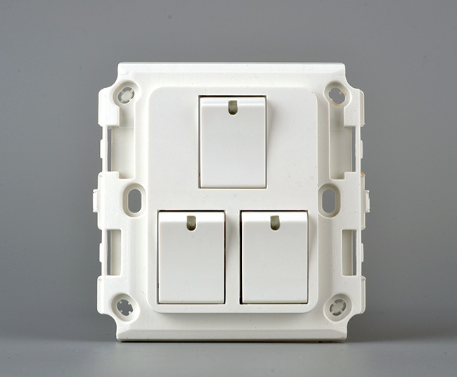 a White 3gang Wall Switch