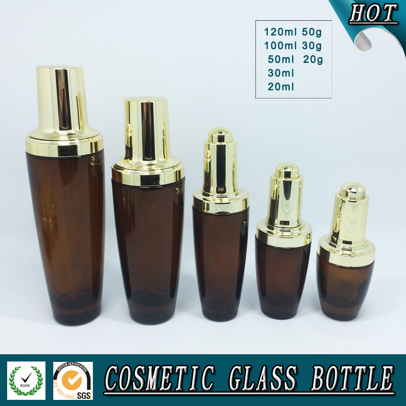 Amber Coloured Cosmetics Glass Bottle and Glass Cream Jar with Shining Gold Lid