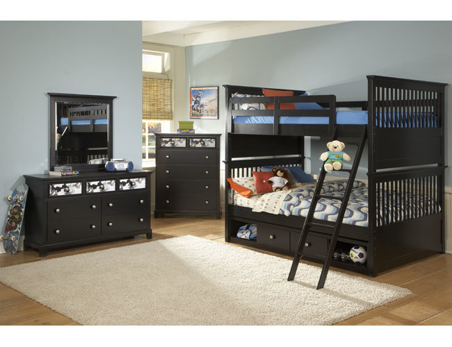 Bunk bed with desk and dresser attached
