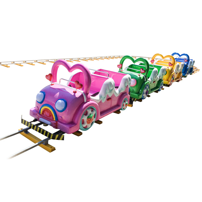 Chasing Colorful Electric Train for Amusement Park