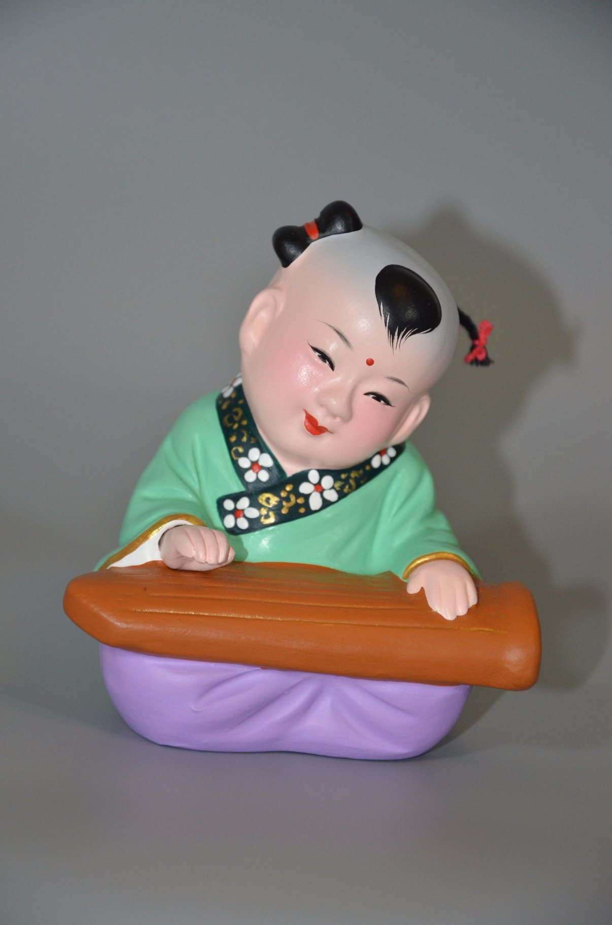 Chinese Traditional Baby Made From Red Clay