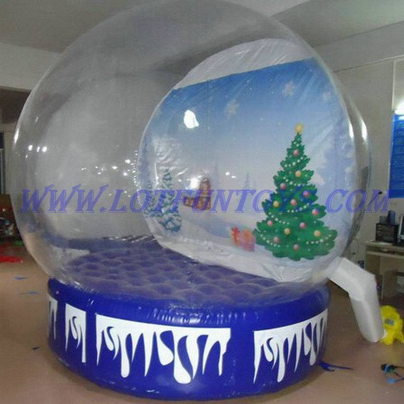 Giant christmas snow globe images for Outdoor christmas globes