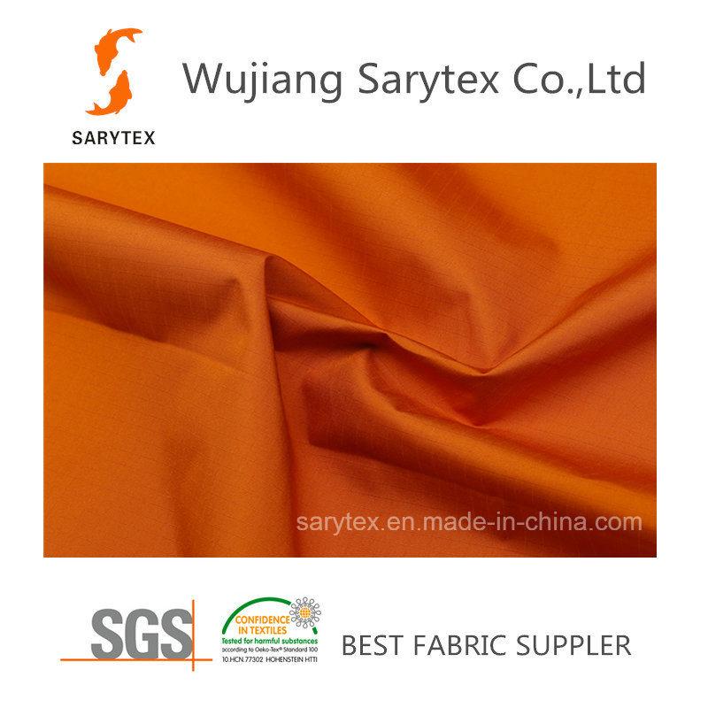 C926/1 80%Polyester 20%PU 100dx75D 152X85 57′133gr/Sm Pd Wr/C8 PU3000/3000mm Breathable Coating.