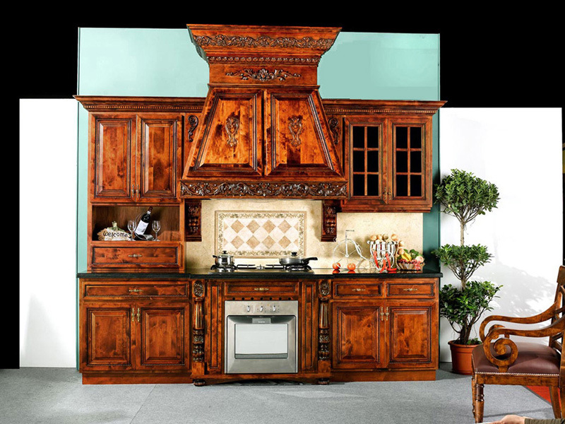 Very-elegant-colonial-kitchen-interior-design-equiped-with-dark-wooden-quality-furniture-tiles-spalsh-back-and-oven
