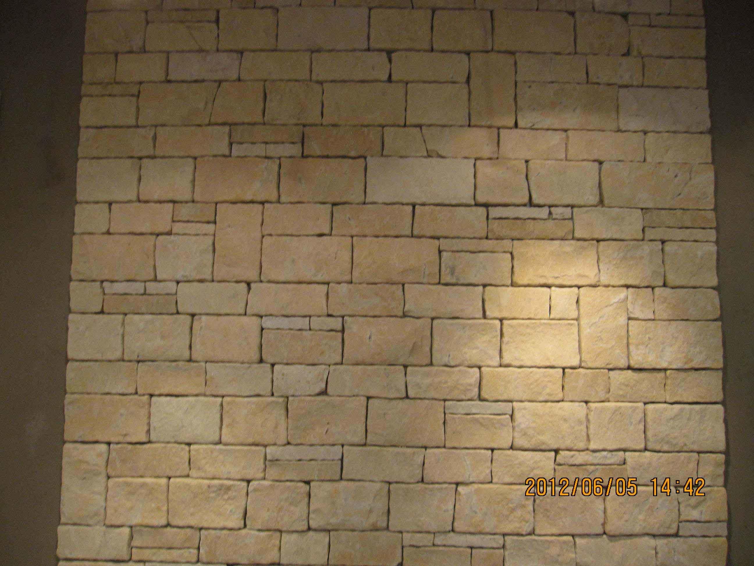 De beige steen van de muur van het kalksteen – de beige steen van ...