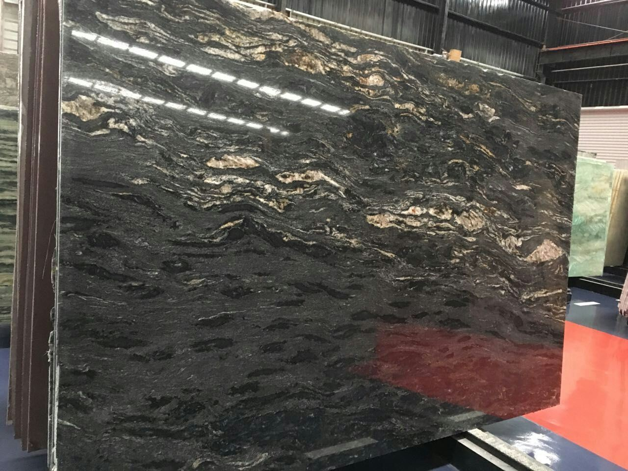 De kosmische zwarte plakken van het graniet van het titanium voor ...