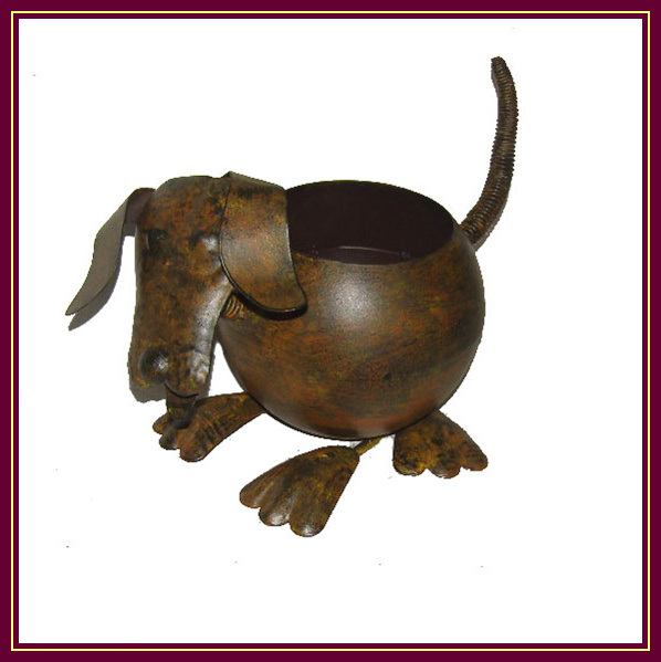 Potes animales del plantador del perro del hierro labrado for Ahuyentar perros del jardin