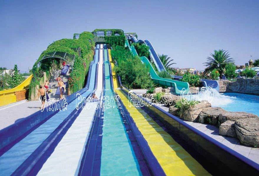 Family racing glissades d 39 eau toboggan photo sur fr made for Cash piscine verre filtrant