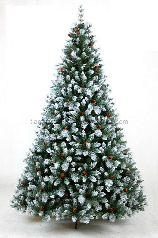Foto de rbol de navidad con los conos de la nieve y del - Arbol navidad nieve ...