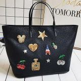 OEM Factory Large Capacity Women Tote Bag PU Leather Handbag with Badge at Low Price Sy8463
