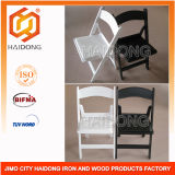 White and Black Resin Folding Chair in Wedding