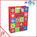 O presente de papel de carimbo quente azul ensaca sacos de papel de compra do Natal
