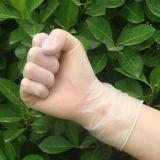 Guanti ginecologici dell'esame a gettare del vinile per uso medico