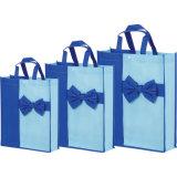 Les sacs de cadeau de promotion, avec conçoivent et classent en fonction du client