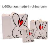 Beaux sacs colorés de cadeau d'achats de papier de carton pour des enfants