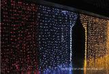 A decoração da cortina do diodo emissor de luz ilumina o casamento do Natal