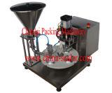 コップのコーヒーカプセルの詰物およびシーリングパッキング機械