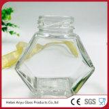 Tarro de cristal hexagonal para el caramelo con el casquillo de plata de la hojalata