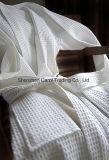 Peignoir blanc de gaufre de coton de textile d'hôtel