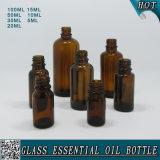 Bottiglia di olio essenziale di vetro ambrata dell'intero insieme con la protezione di plastica dell'oro con la spina
