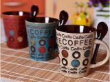 Taza de café al por mayor del gres 12oz con la cuchara en maneta