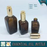 Bouteille en verre carrée ambre d'huile essentielle avec le compte-gouttes de pompe de presse