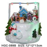 Casa do Natal da resina com a vila do Natal do diodo emissor de luz