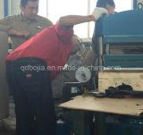 고무는 가황기 고무 벽돌 만든 기계를 타일을 붙인다