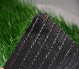 La hierba sintética del fútbol se divierte el césped artificial (el SE)