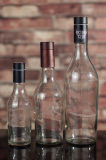 Bottiglie di vetro del triangolo su ordine