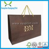 Encargo del bajo costo del papel de Kraft Bolsa de la compra con el logotipo de la impresión del oro