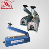 Máquina del lacre de la mano con la plataforma de la película del cortador y del rodillo para el sello y el corte de los bolsos del embalaje