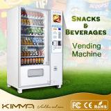 Bocado del sitio de la rotura y máquina expendedora de las bebidas con la pantalla del anuncio