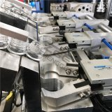 フルオートマチックの4つのキャビティプラスチックびんの打撃機械および打撃のプロセス価格
