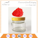 Caviale rosso, vaso di vetro d'inscatolamento del caviale nero con la protezione del metallo