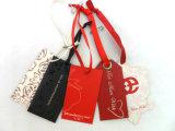 Precio de fábrica de lujo etiquetas colgantes para ropa