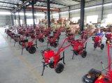 9HP 6.6kwのディーゼル耕うん機、力の耕うん機は、回転式耕うん機のディーゼル機関の耕うん機を耕作する